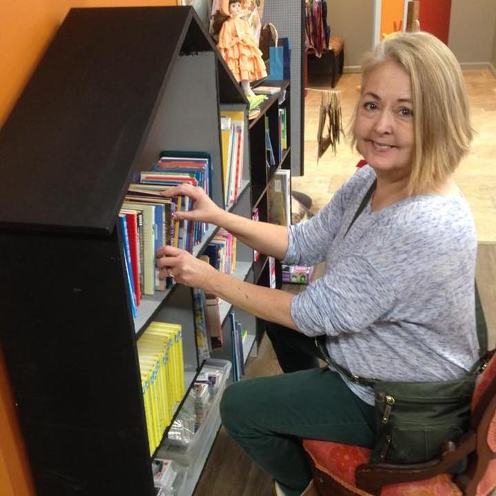 Jackie organizes books
